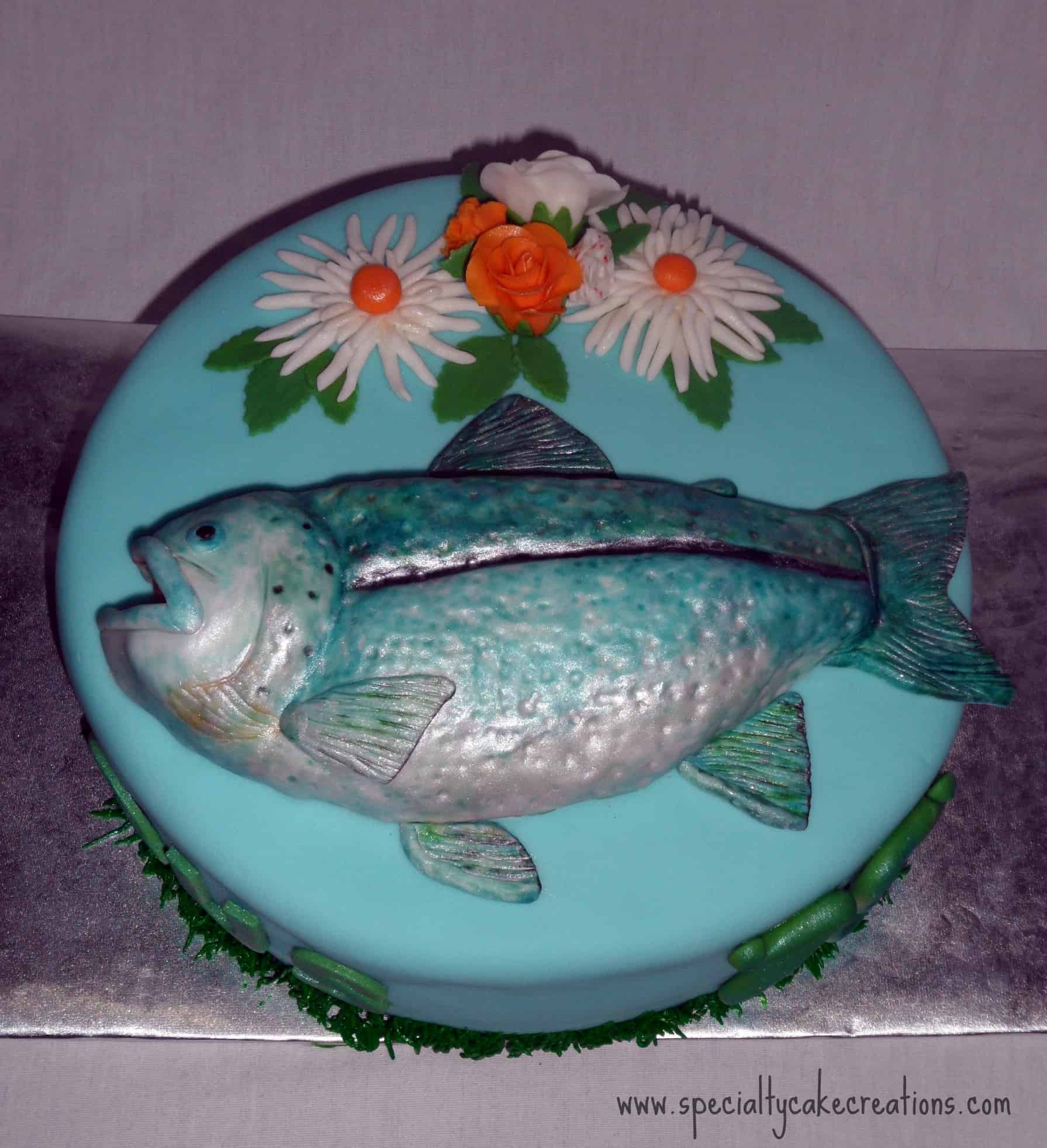 Specialty fish and flowers birthday cake for Fish birthday cake
