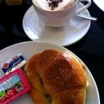 Croissant and Foamy Cappuccino