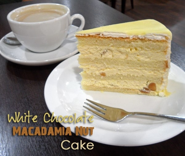 In this White Chocolate Macadamia Cake spongy cake layers are filled ...