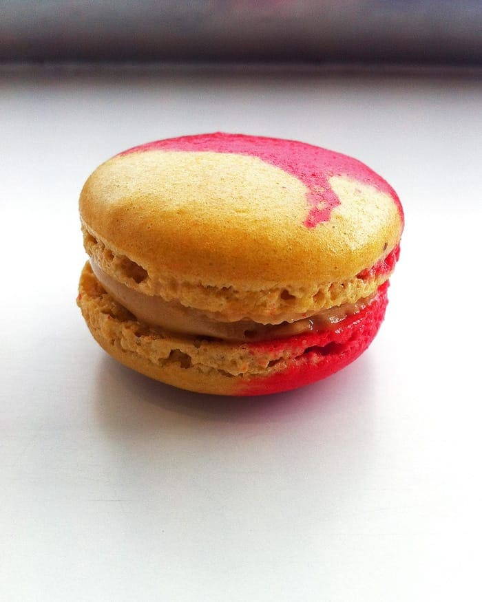 Two colored Peanut Butter Macarons | leelalicious.com #macarons #peanutbutter
