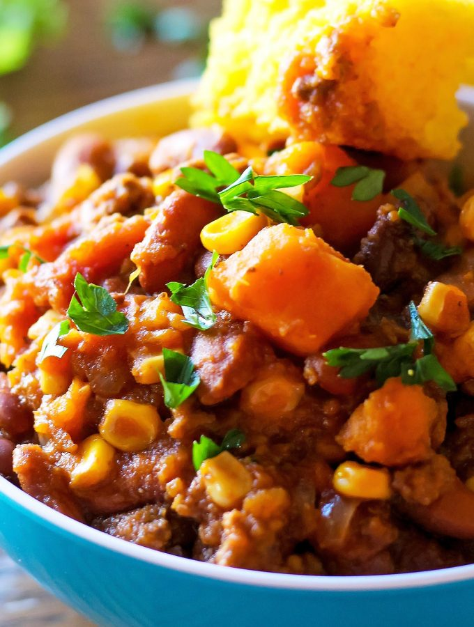 Slow Cooker Sweet Potato Chili with cornbred slice