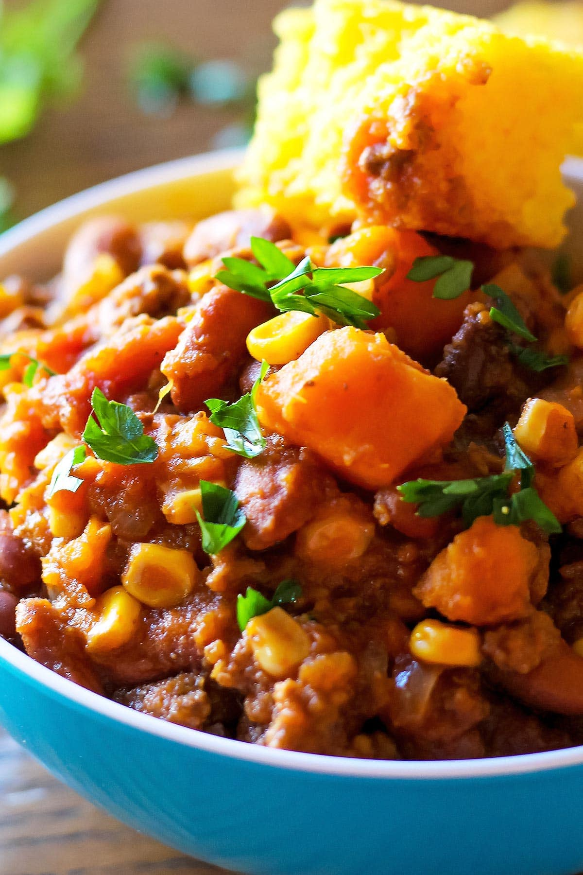 Sweet Potato Chili with cornbread slice
