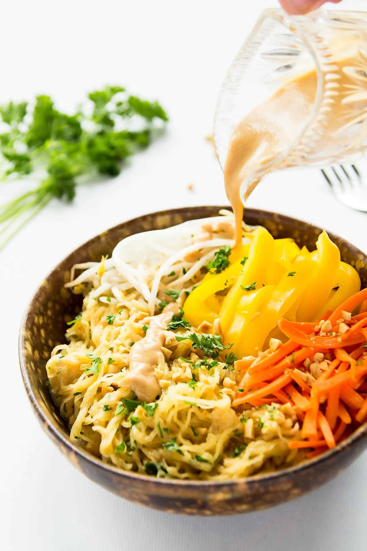 Healthy Thai Spaghetti Squash with delicious peanut sauce makes a great side dish or base for a grain-free Pad Thai recipe. This recipe is gluten-free, vegan, and clean eating. The peanut sauce makes a great dip too.