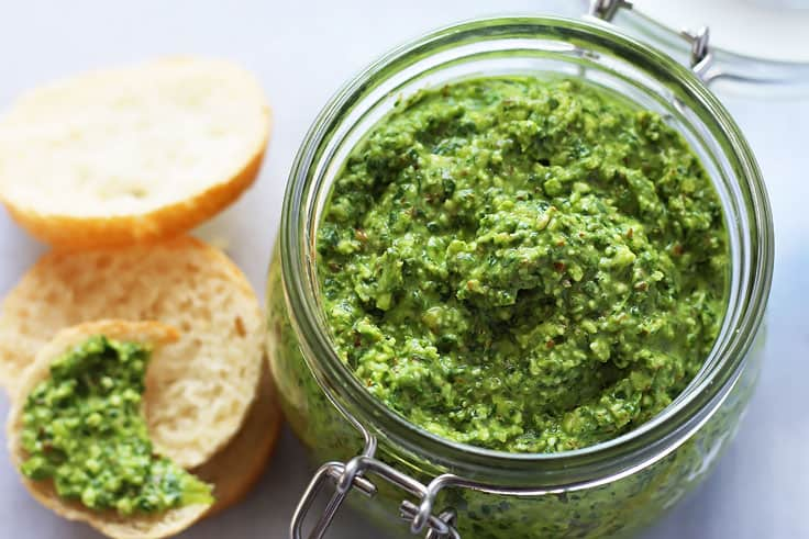 This flavorful pesto is made with spinach, almonds and feta cheese. With its coarse texture this pesto also makes a fantastic dip. #pesto #appetizer