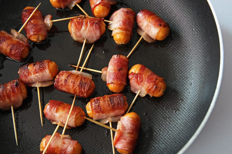 These bacon-wrapped mini hot dogs make an amazing party appetizer. Dipped in homemade Thai sweet chili sauce they are going to be a guaranteed hit.