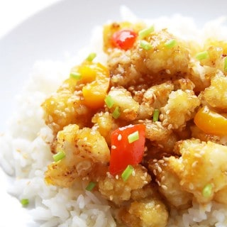 This Cauliflower Stir Fry in Orange Sauce is a vegetarian version of Orange Chicken takeout. Delicious meatless takeout made quick and easy at home.