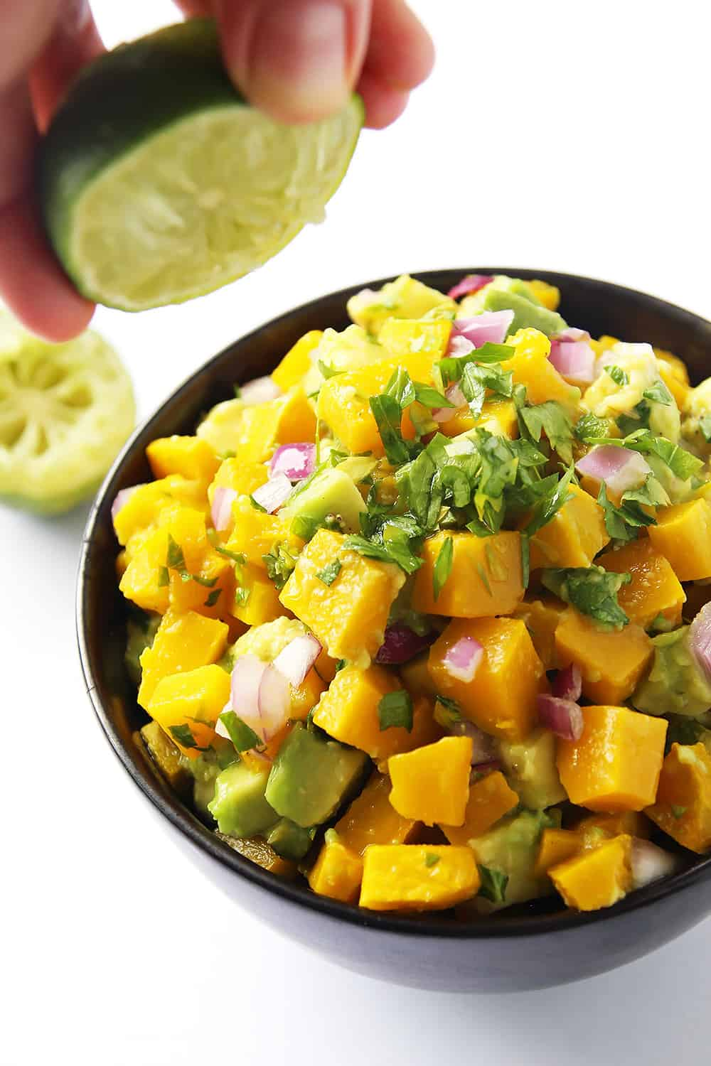 Pumpkin Avocado Salsa is a refreshing seasonal twist on the classic dip and condiment. With roasted pumpkin and creamy avocado this salsa is great served with tacos and grilled meats.