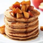 Fluffy Whole Wheat Apple Pie Pancakes paired with a delicious Apple Caramel Topping. A wholesome dessert-for-breakfast recipe that is refined sugar free.