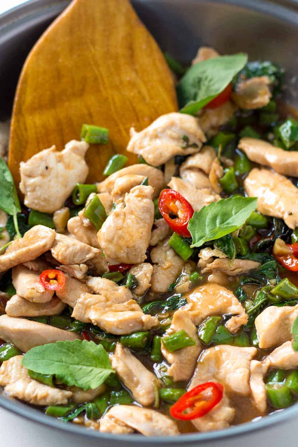 Thai Basil Chicken Stir Fry is a quick and easy dish that is incredibly flavorful. Served alongside steamed rice it's perfect for weeknight dinners - much better and faster than take-out.