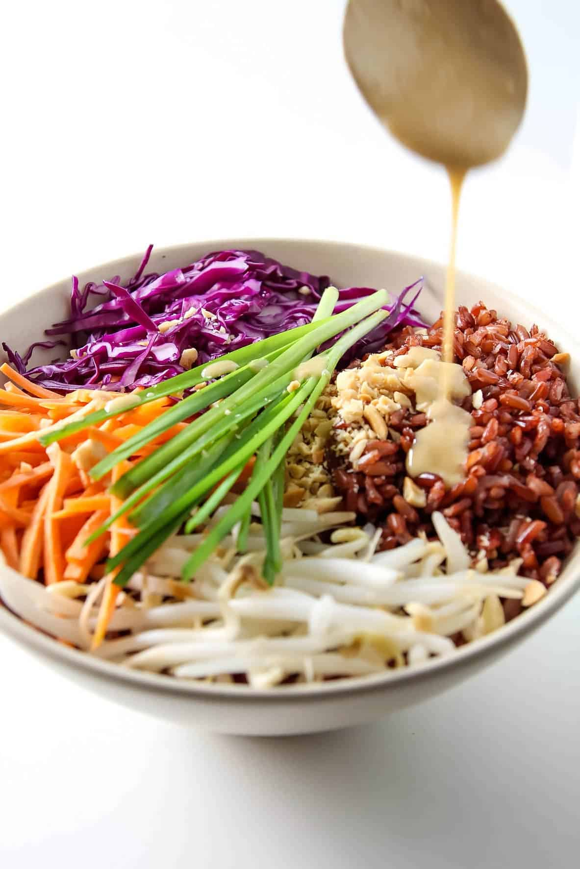 Thai Buddha Bowl with Peanut Sauce - this healthy recipe with red rice is gluten free, vegan and clean eating.