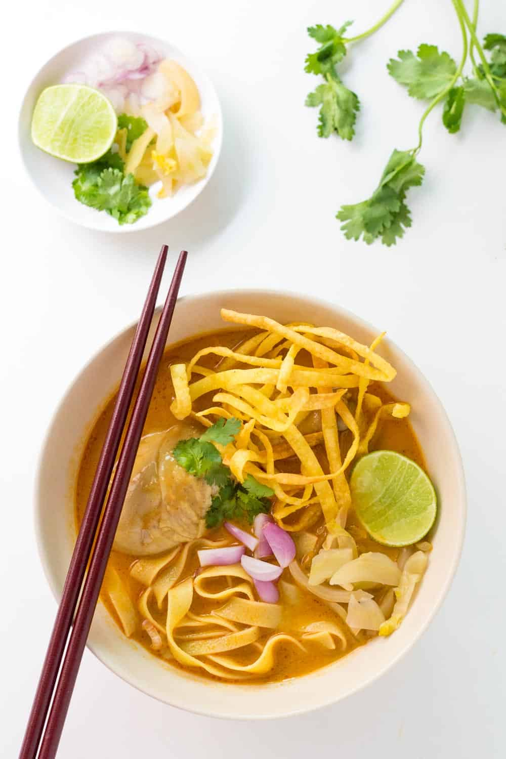 This is an easy recipe for Khao Soi - a Northern Thai Coconut Curry Soup with Egg Noodles and Chicken. It is an amazingly balanced dish with spicy, sweet, creamy, and crispy elements.