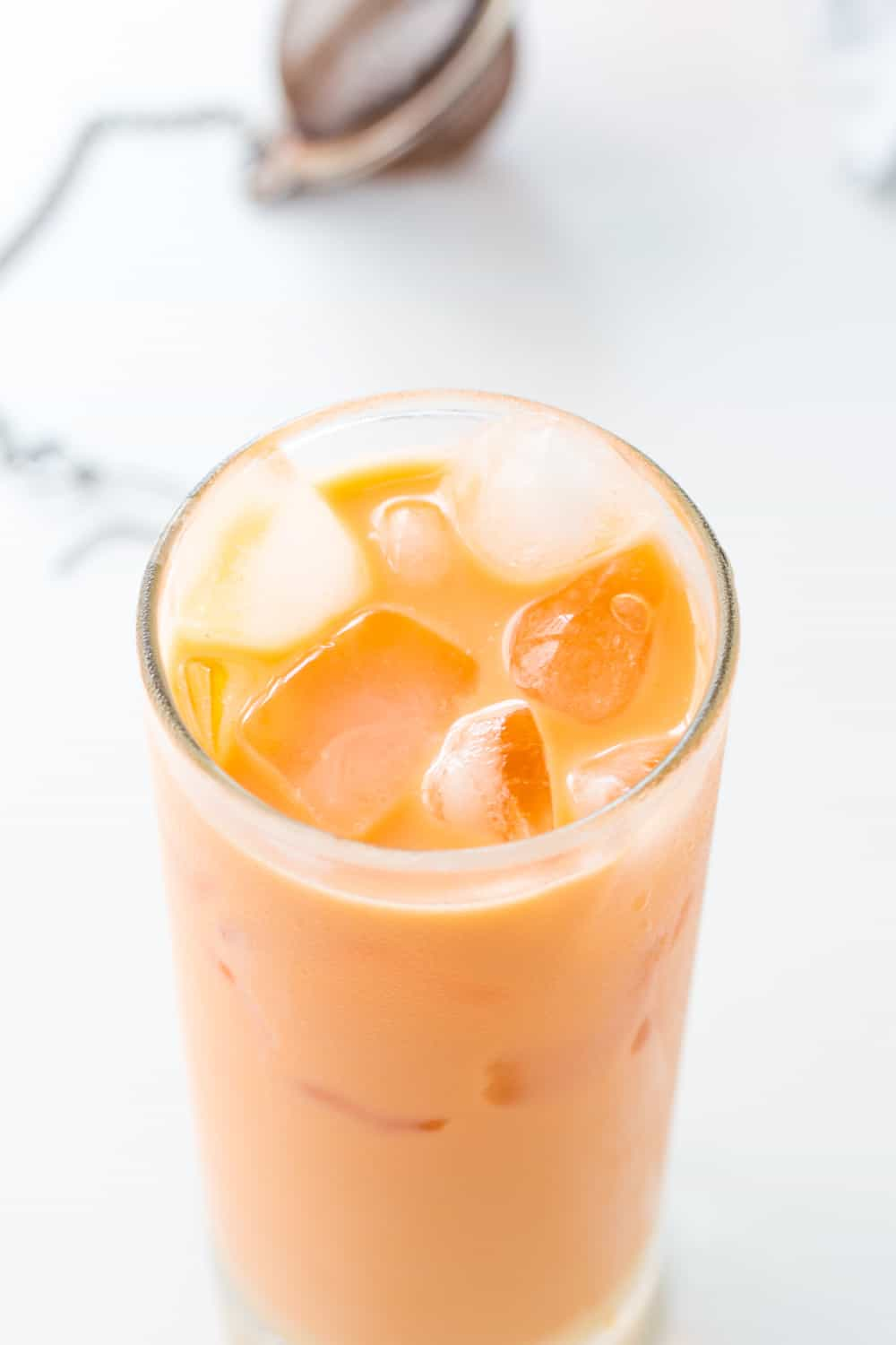This refreshing Thai Iced Tea with Milk is perfect to accompany a spicy Thai food dinner. This homemade recipe uses palm sugar and coconut milk in place of evaporated and sweetened condensed milk to make it dairy free.