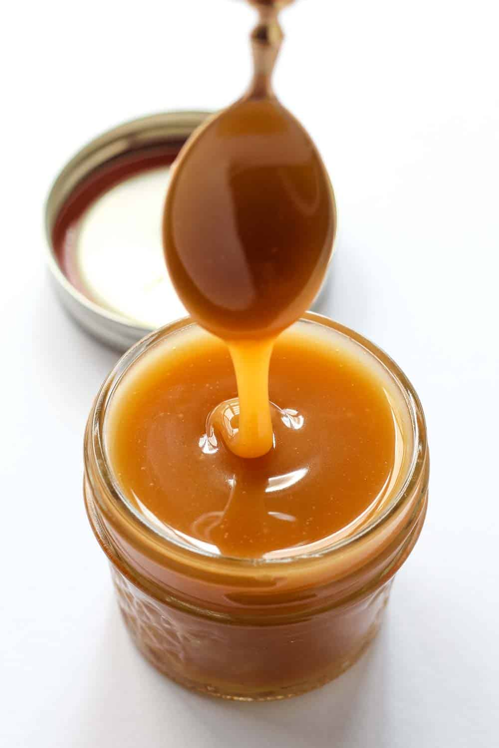 Learn how to make delicious Vegan Caramel Sauce with coconut milk. This awesome recipe is not only dairy free but also uses no refined sugar so it is clean eating and paleo friendly.