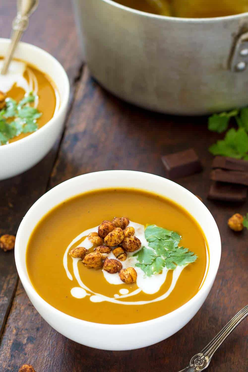 This velvety smooth chocolate roasted Butternut Squash Soup is topped with crunchy chili + cocoa roasted chickpeas. Thanks to the unique combination of dark chocolate, chili and spices this creamy soup has an aromatic mole-like richness, which makes it both perfect as an appetizer or main course.
