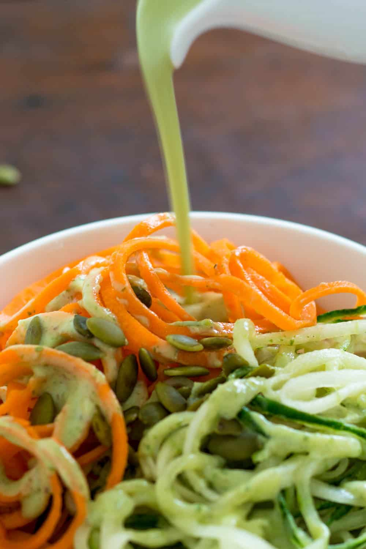 Drizzling Avocado Dressing on Salad