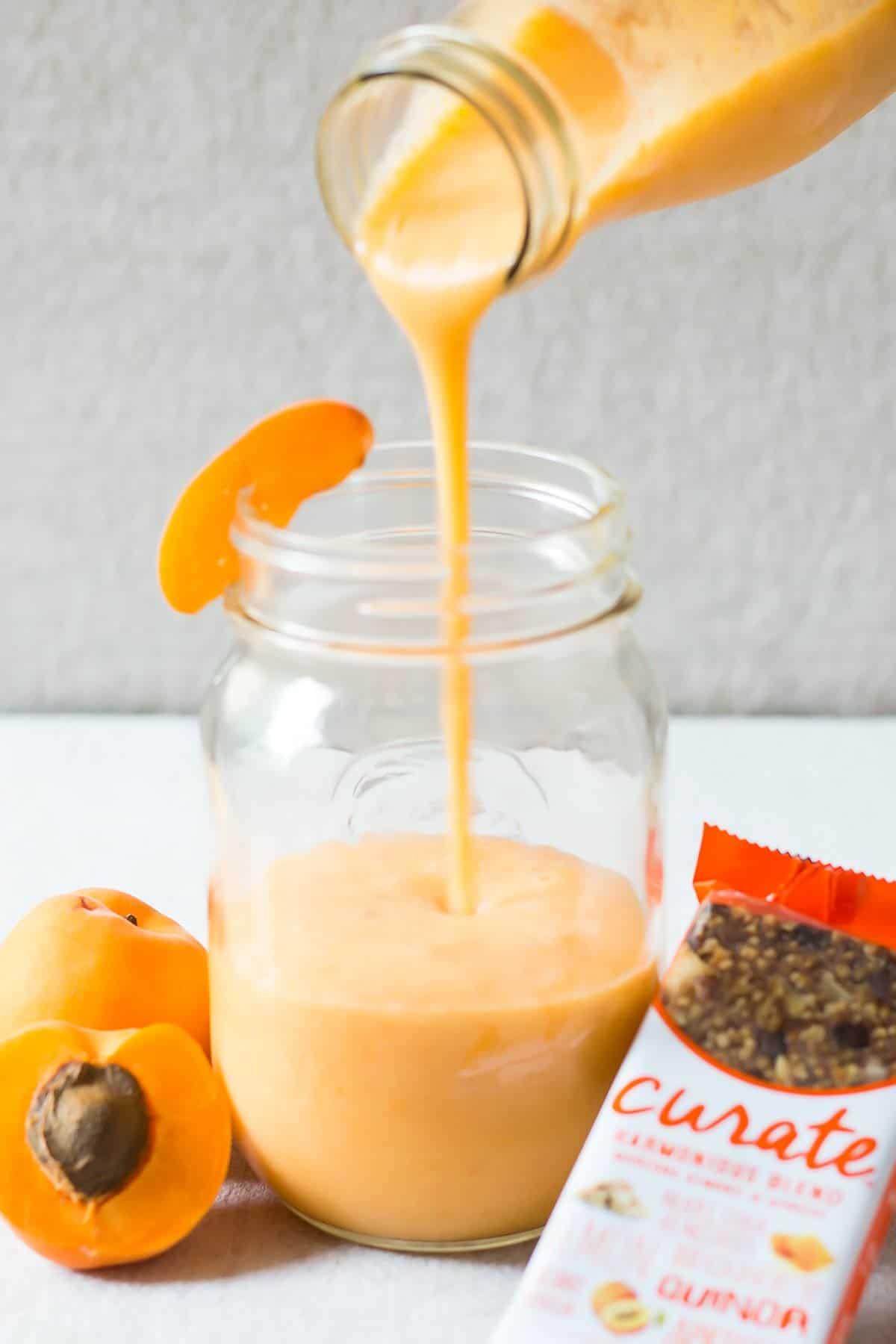 Pouring Almond Milk Apricot Smoothie