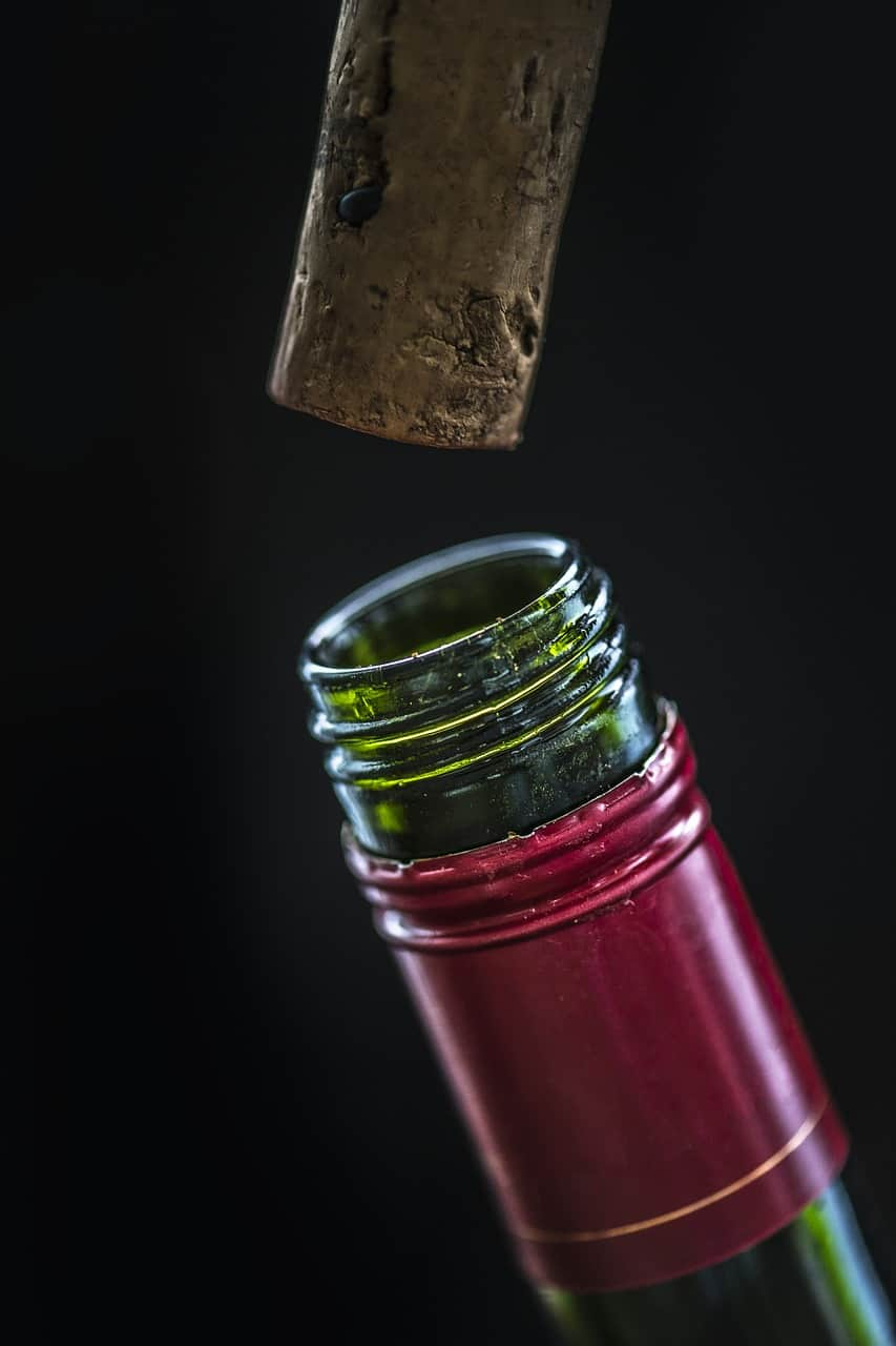 Cork being removed from wine bottle