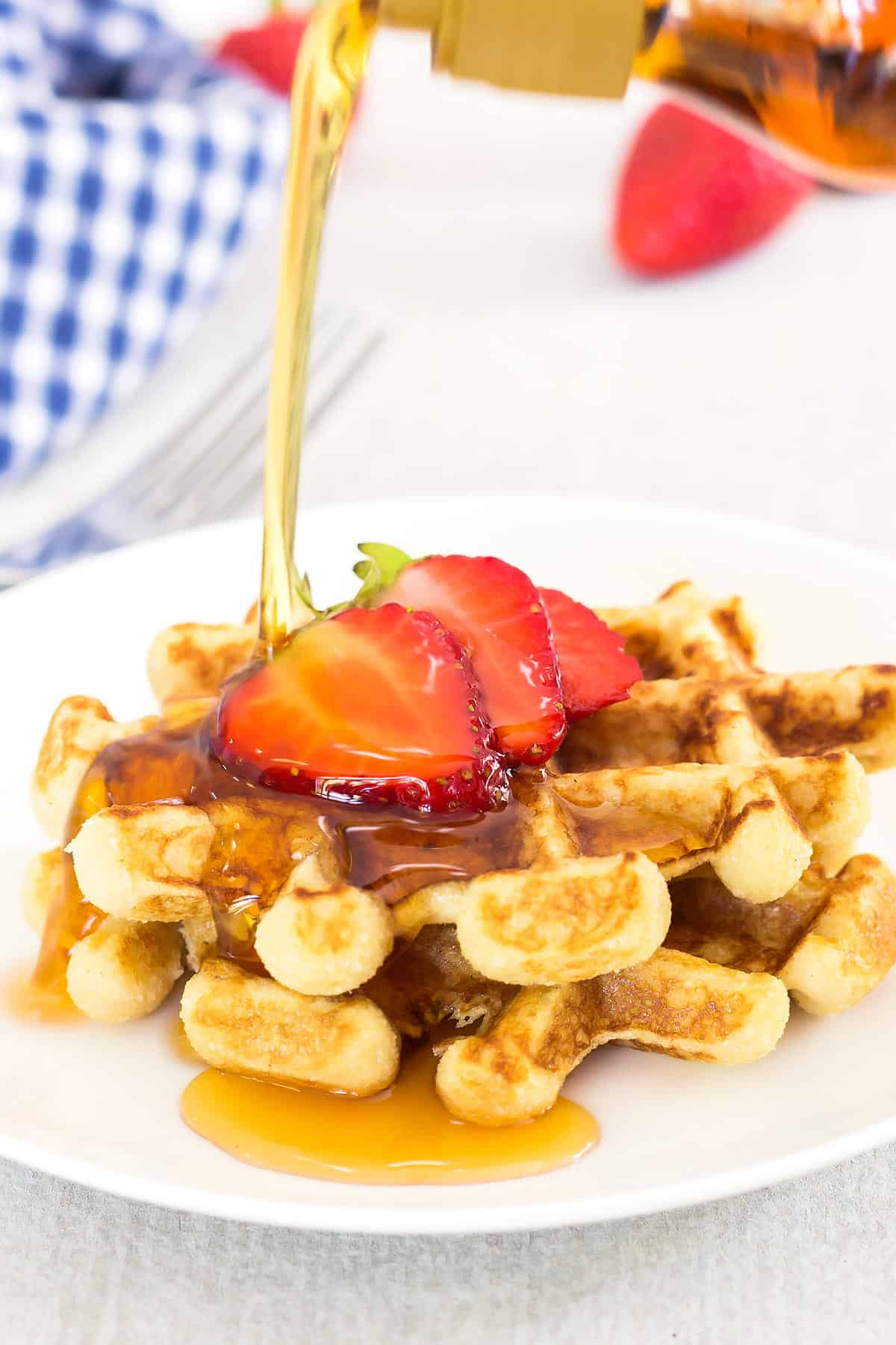 Paleo Coconut Flour Waffles being drizzled with maple syrup