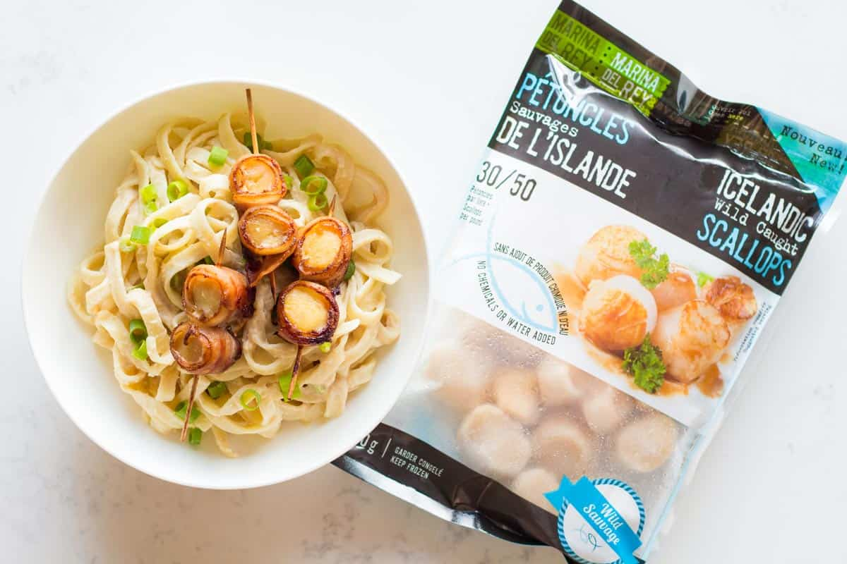 Scallop Carbonara in bowl with bag of frozen scallops on side
