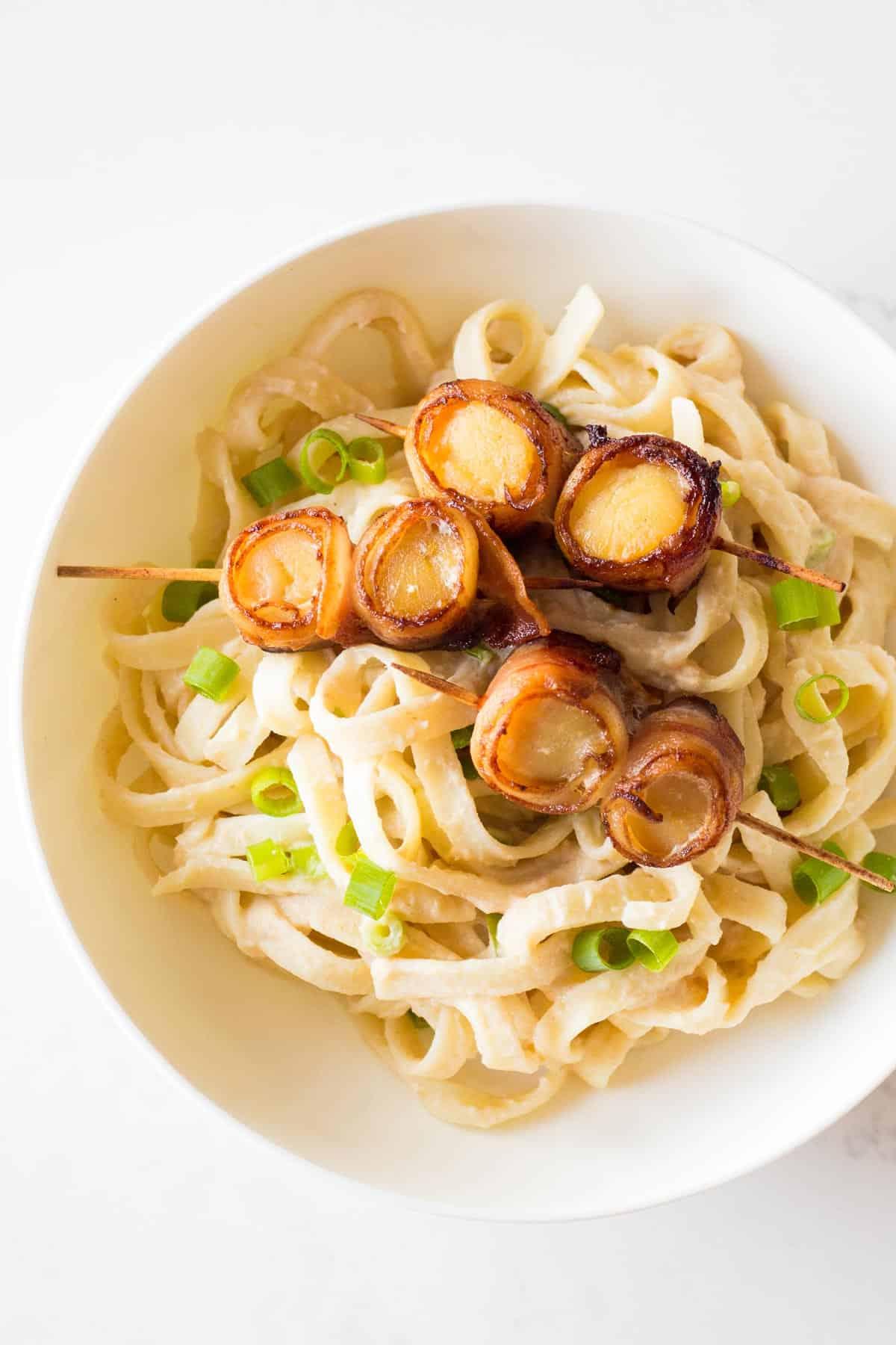 Scallop Pasta in white bowl