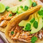 Pressure Cooker Shredded Chicken Tacos on wooden board