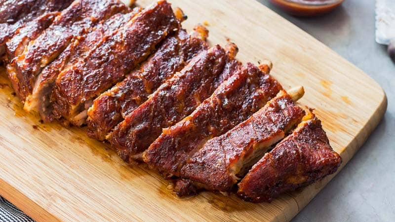 BBQ Ribs on a wooden cutting board