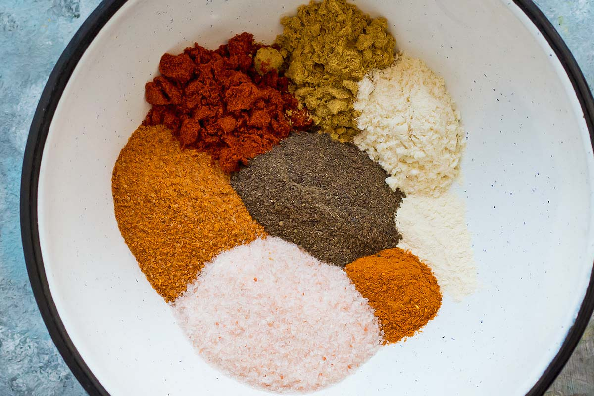 Spices for Homemade Chili Seasoning arranged next to each other in white bowl