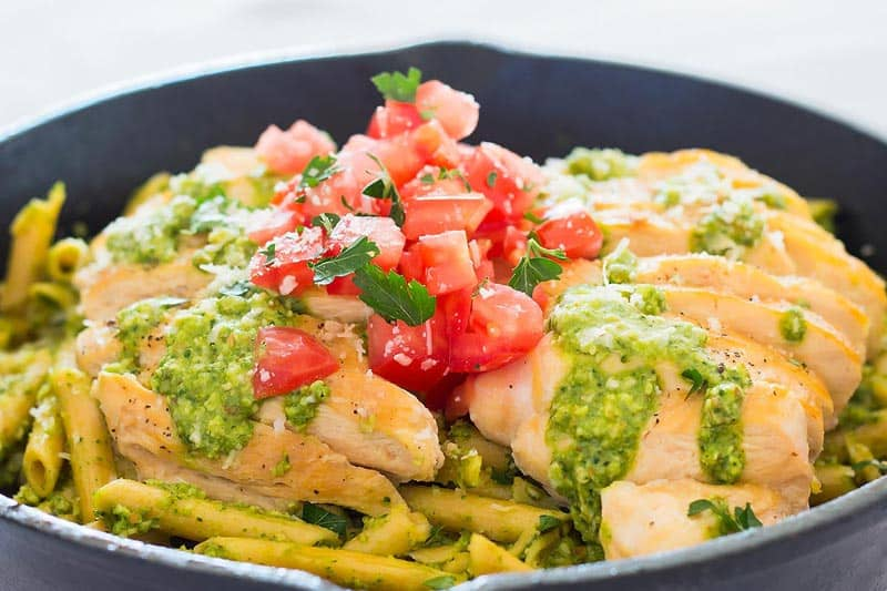 Close up of pesto chicken pasta in a skillet