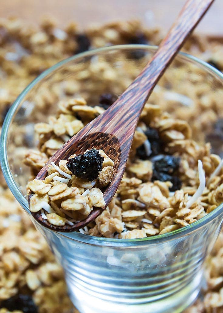 Crunchy Peanut Butter Granola Cereal in a glass and on a spoon