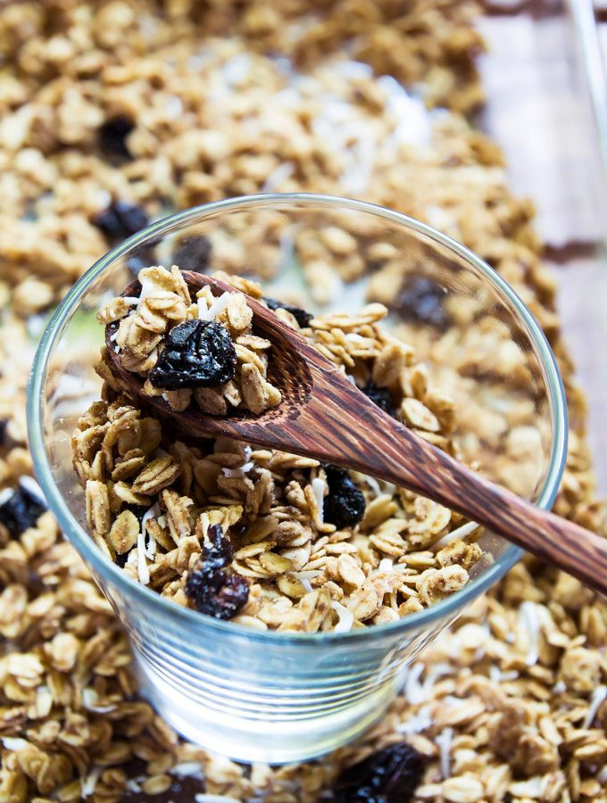 Homemade Granola in a glass with a spoon