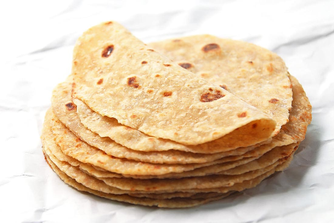 Stack of homemade whole wheat tortillas