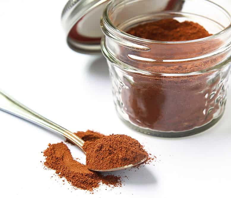 Pumpkin Spice Mix in a jar and on a spoon