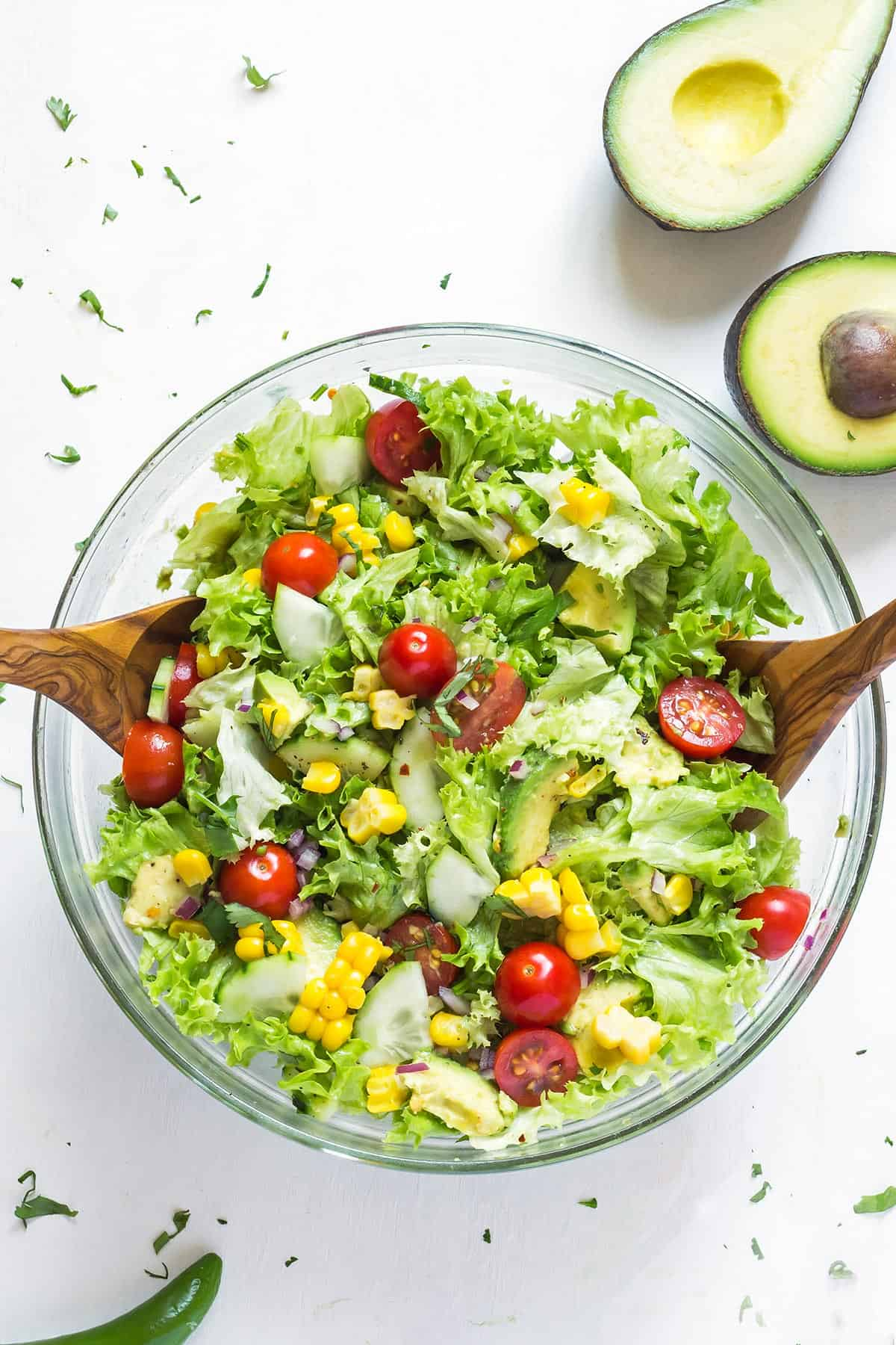 Overhead view of Avocado Corn Salad in a glass bowl