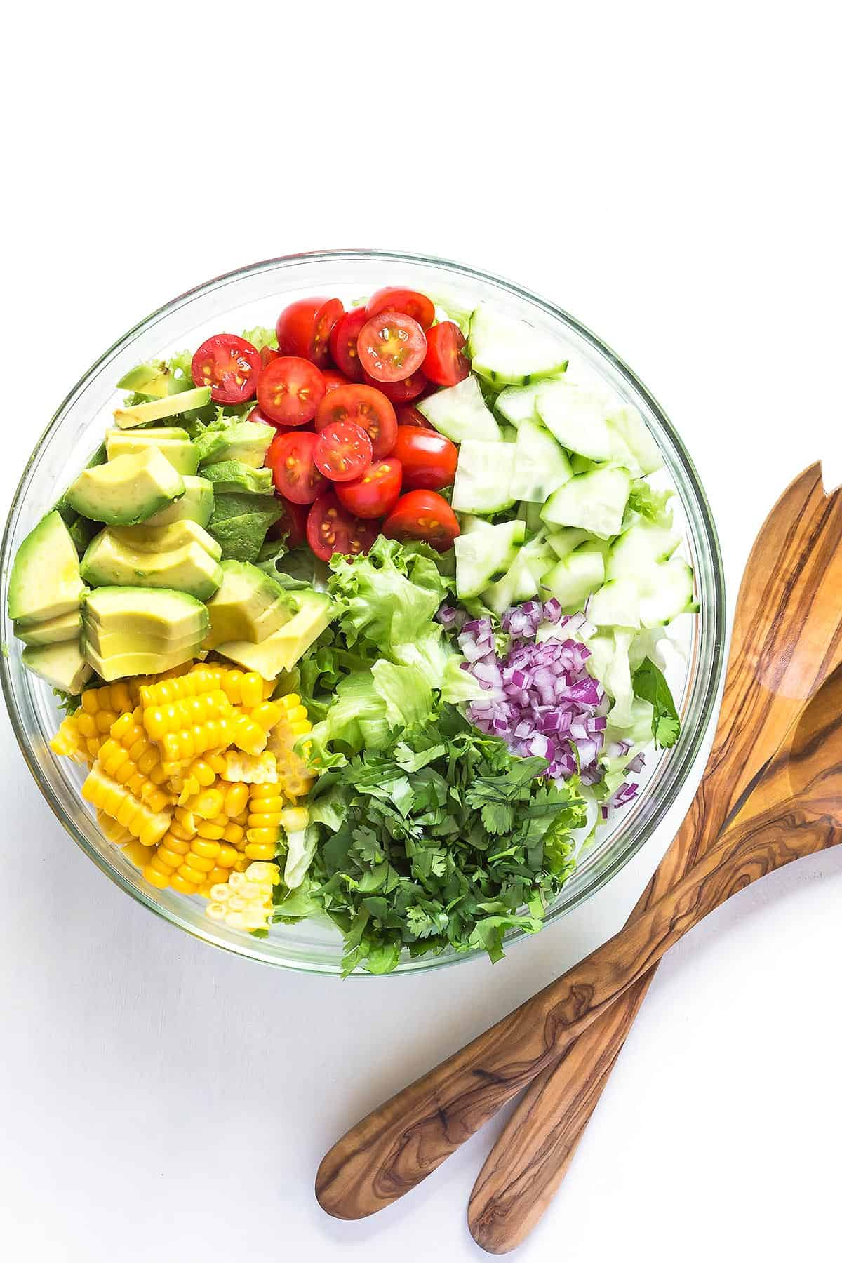 Corn And Avocado Salad ingredients arranged side by side in a bowl