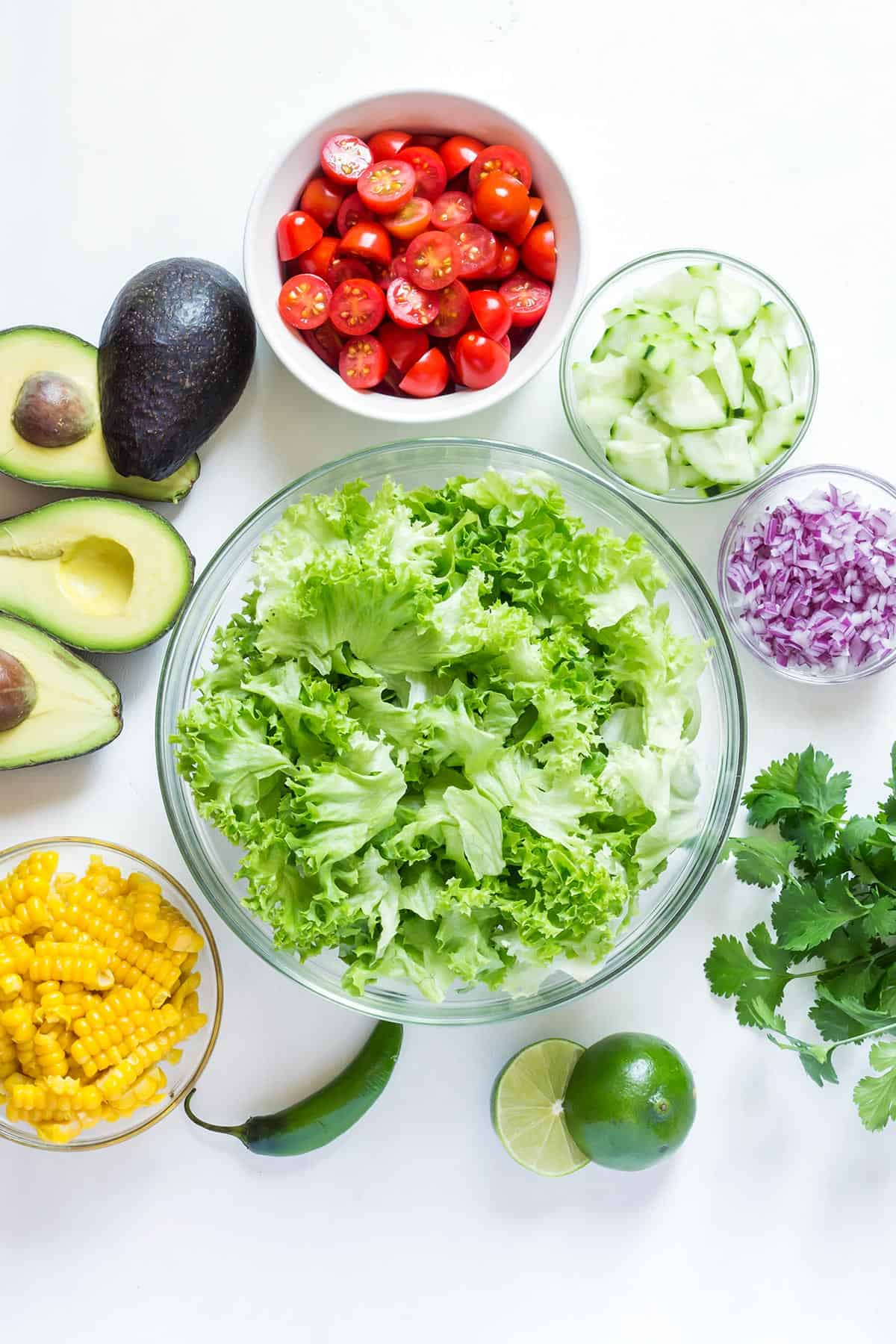 Avocado Corn Salad ingredients in individual bowls