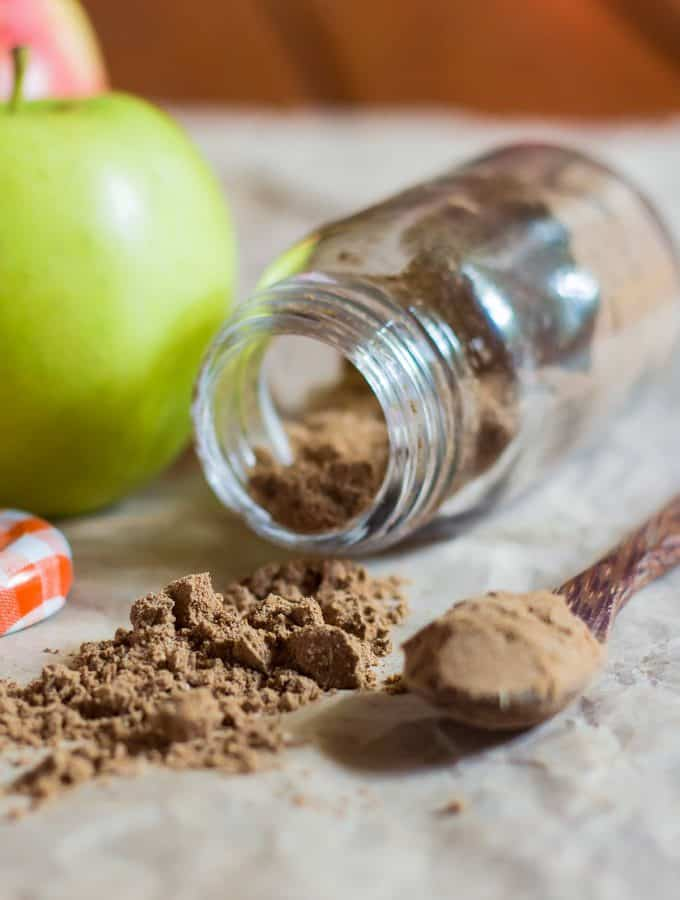 Apple pie seasoning mix in a laying down spice jar
