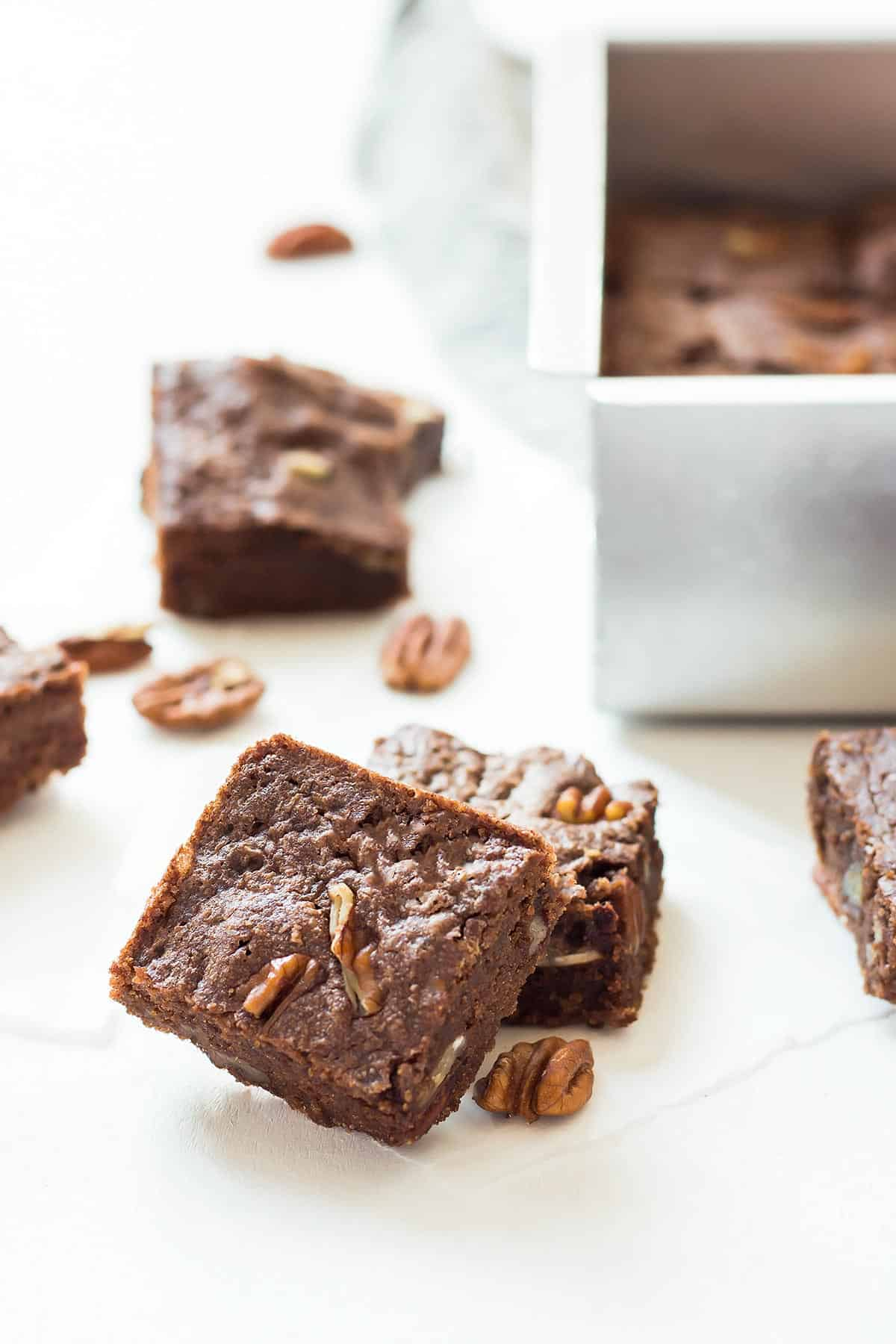 Pieces on Ketogenic brownies on a piece of parchment paper