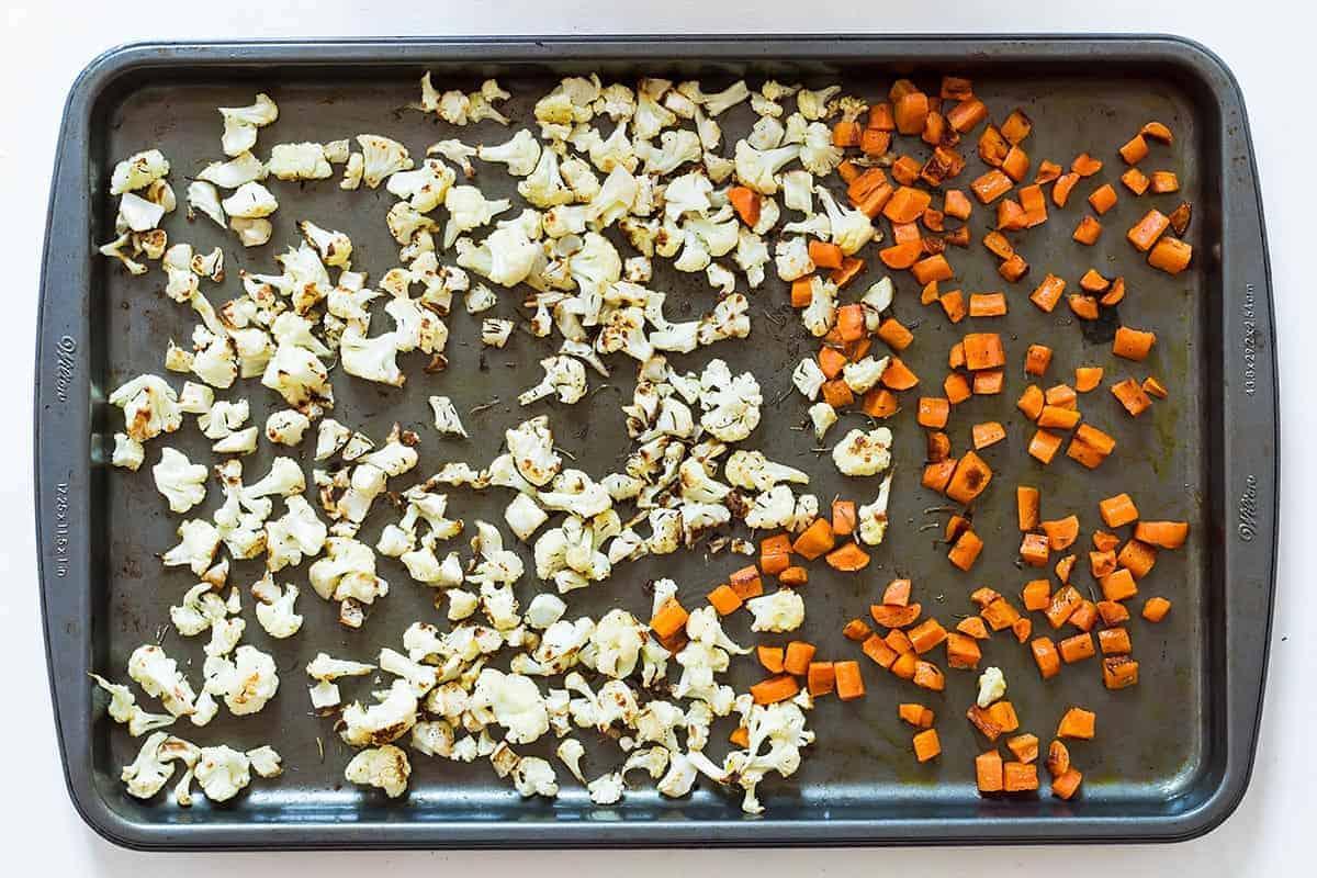 Roasted cauliflower and carrots on baking sheet for cauliflower stuffing