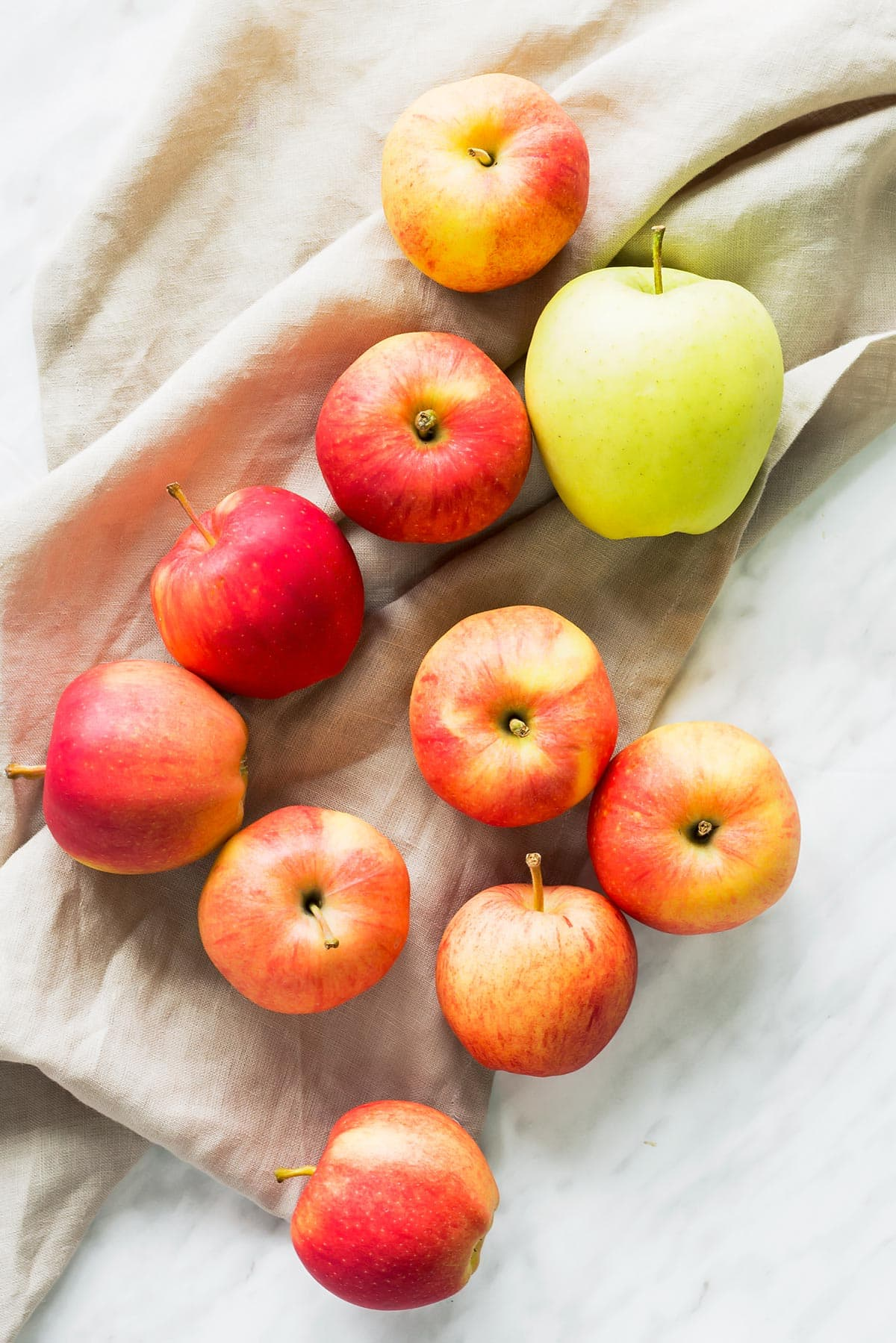 Best Apples for Applesauce laid out on table