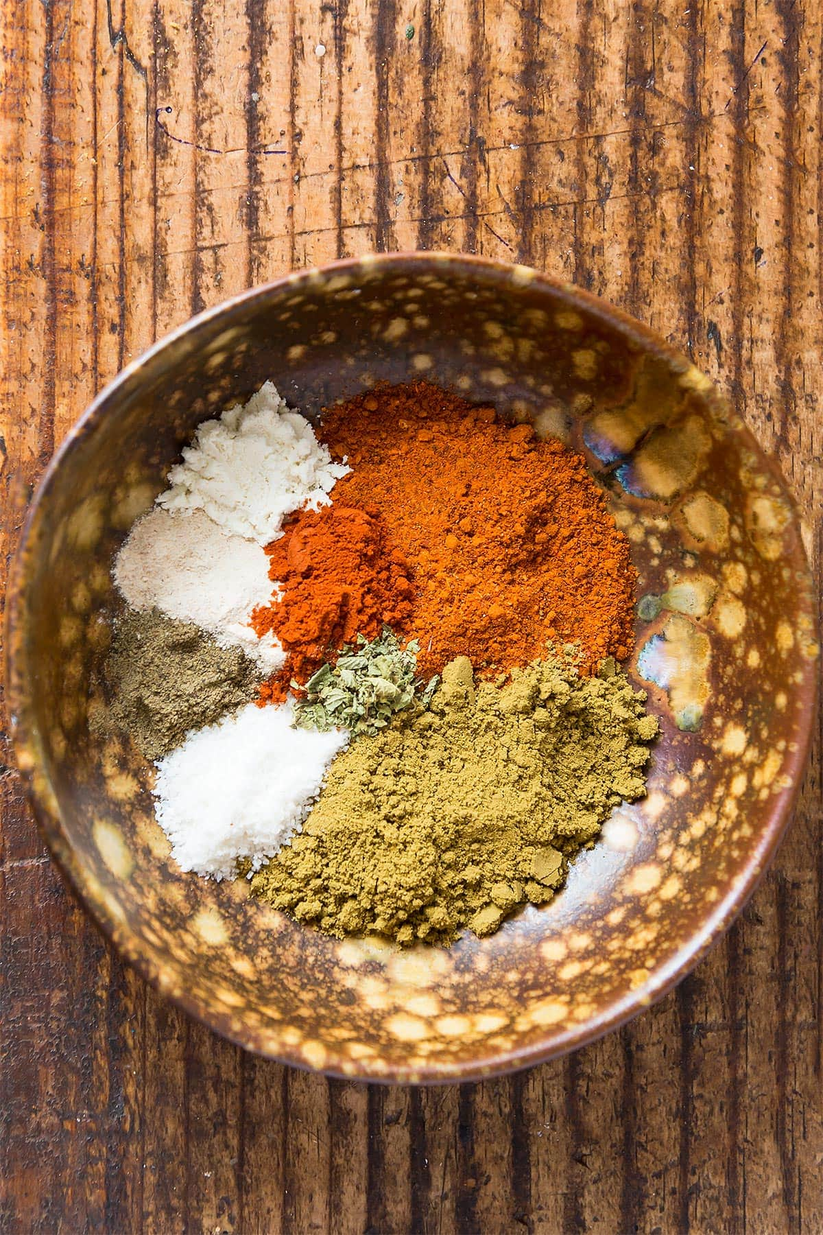Homemade Taco Seasoning spices measured out in a bowl