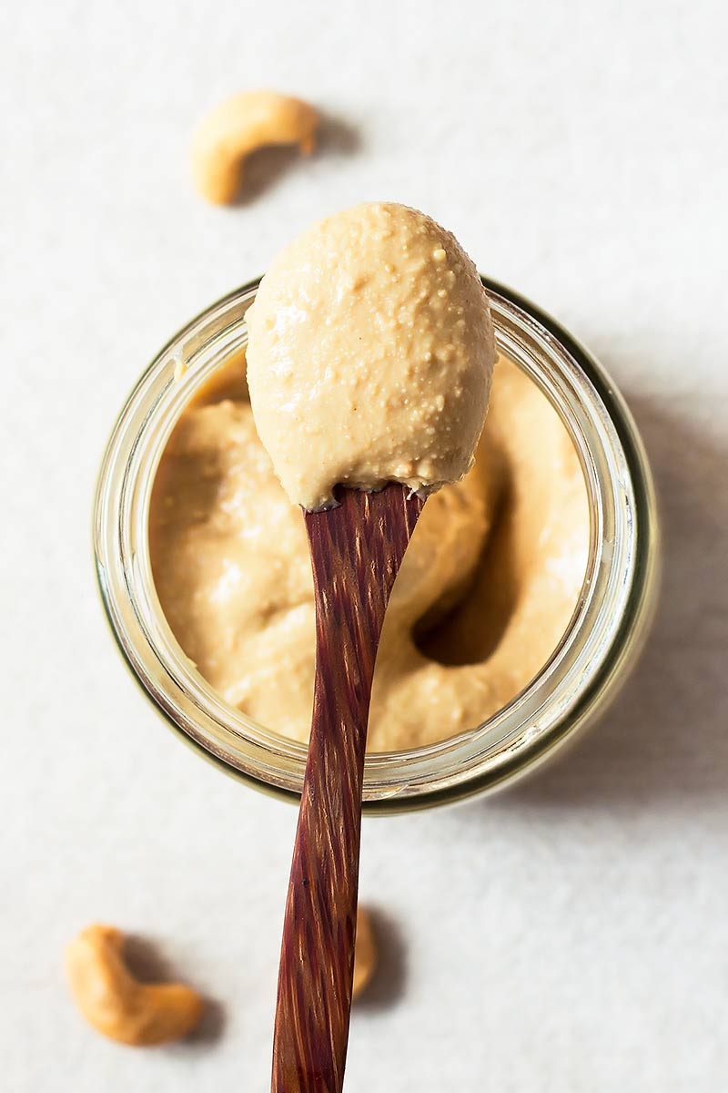 Cashew Butter on a spoon from a jar