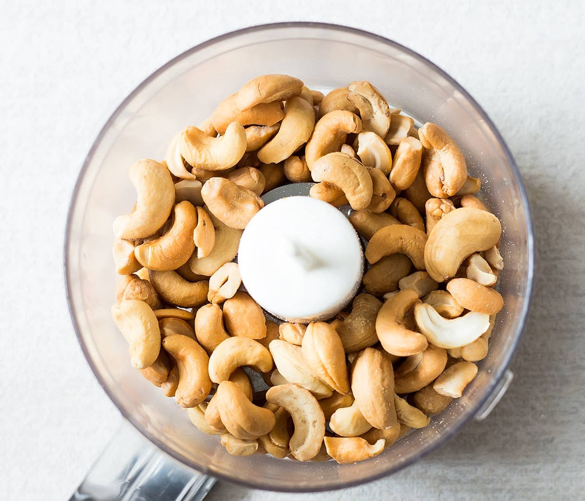 Roasted cashews in food processor for cashew nut butter