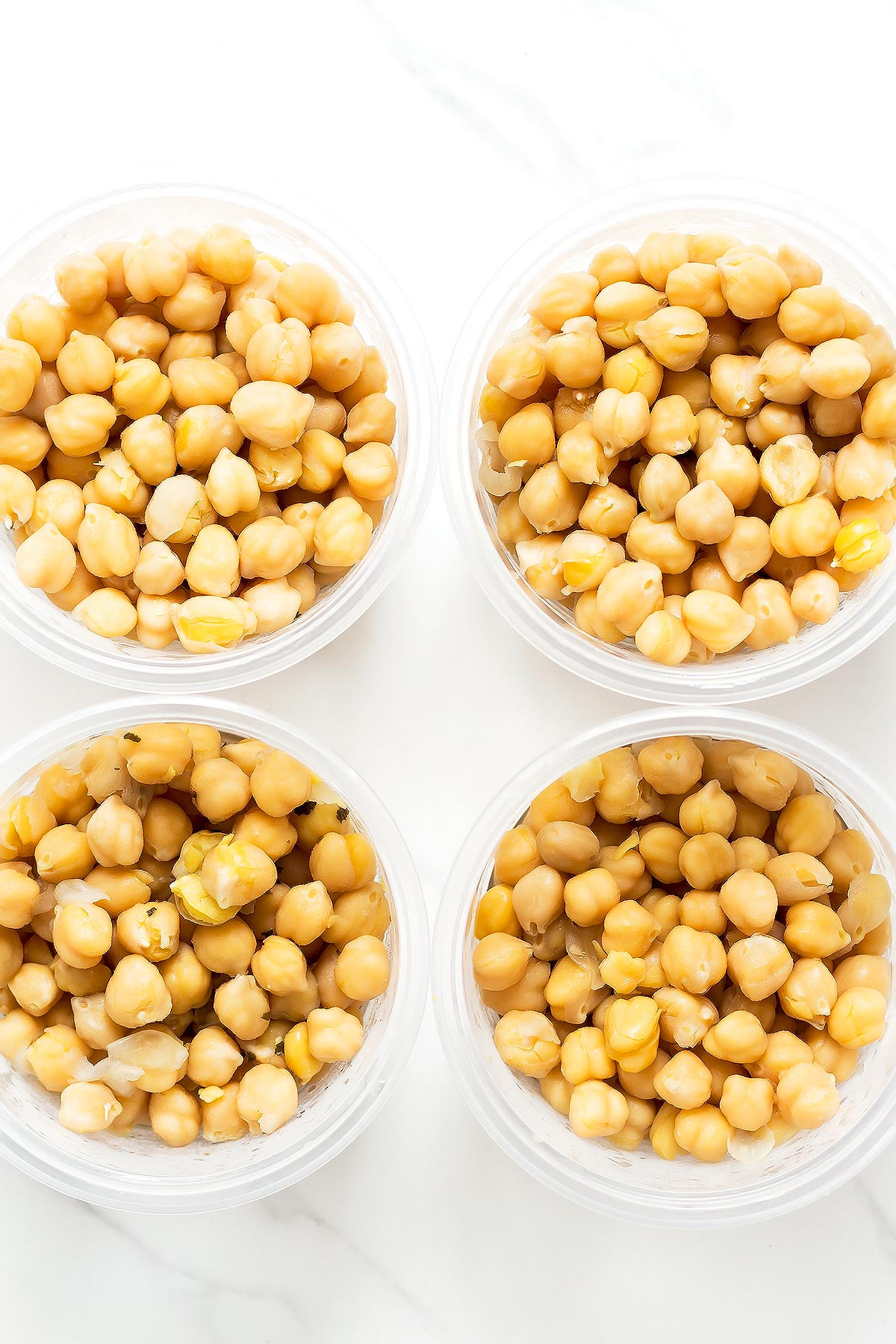 Cooked chickpeas in round storage containers