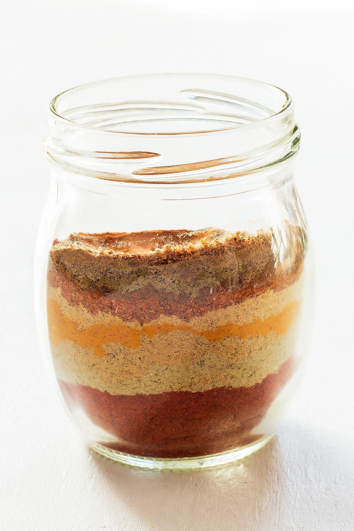 Tandoori Masala spice ingredients layered in jar