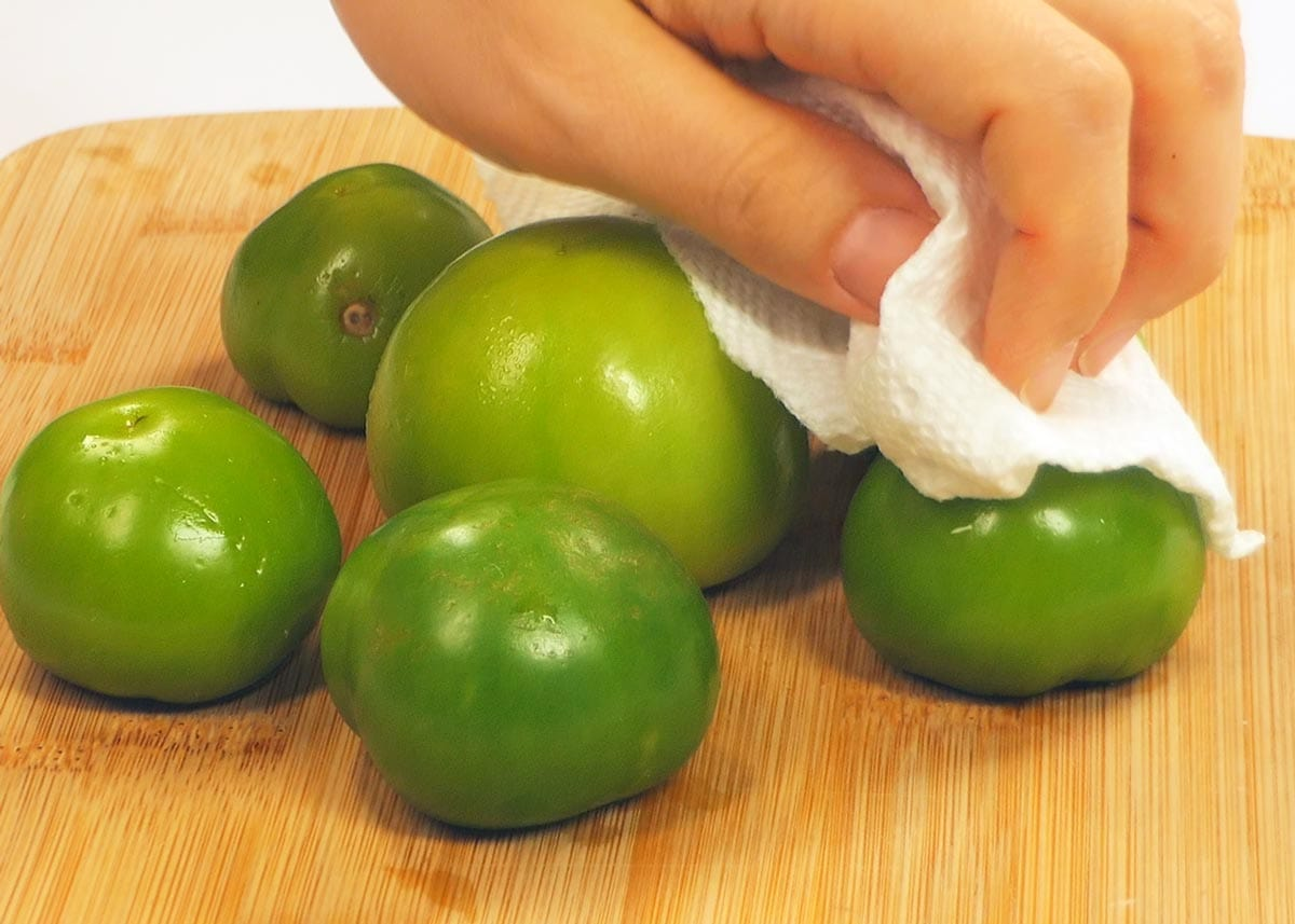 Tomatillos wiped with cloth