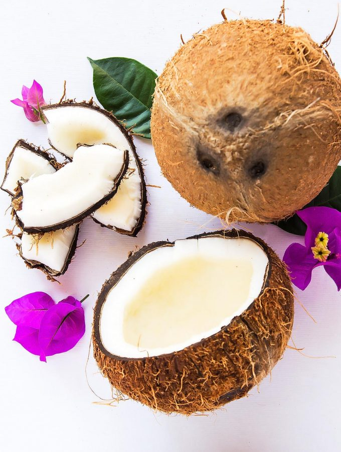 Fresh coconuts with purple flowers