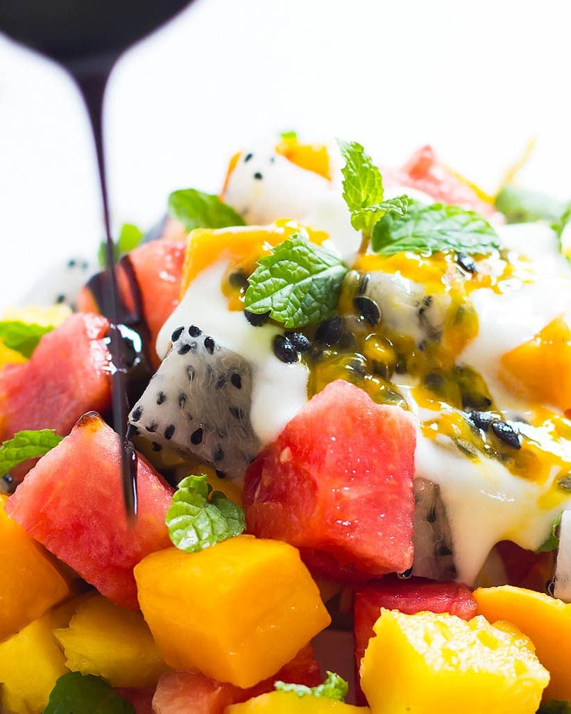 Exotic Fruit Salad with yogurt, balsamic reduction, passion fruit