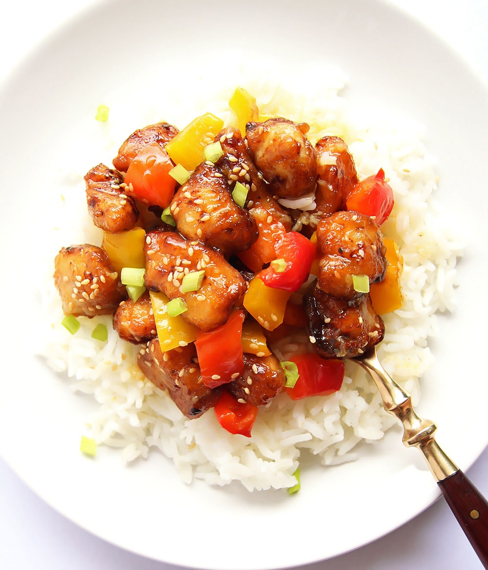 Honey Orange Chicken on a plate with rice