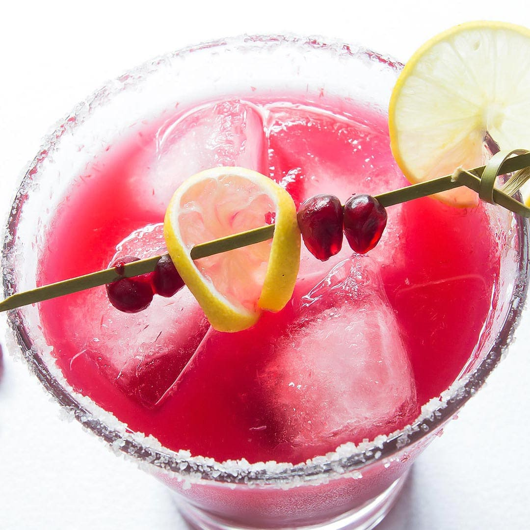 Pomegranate Margarita Recipe with decorated stir stick