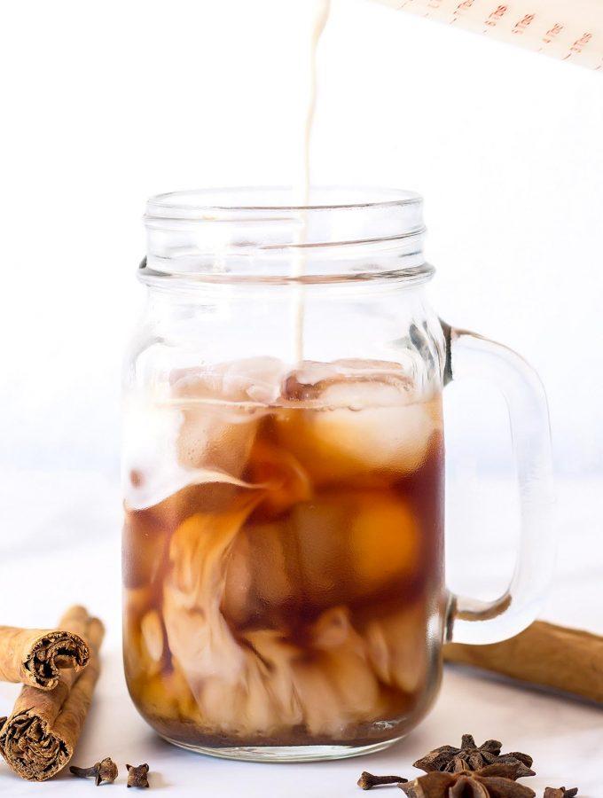 Milk pouring into Iced Chai Tea
